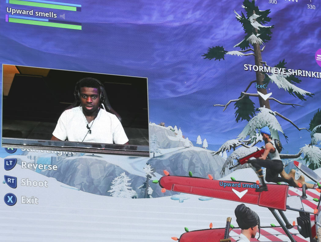 """Vegas Golden Knights goaltender Malcolm Subban is displayed on a giant display while playing """"Fortnite"""" with fans at the HyperX Esports Arena inside the Luxor in Las Vegas on Tuesday, De ..."""