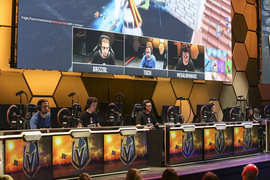 """Vegas Golden Knights right wing Alex Tuch, seated at left, plays """"Fortnite"""" with fans at the HyperX Esports Arena inside the Luxor in Las Vegas on Tuesday, Dec. 18, 2018. Richard Brian L ..."""