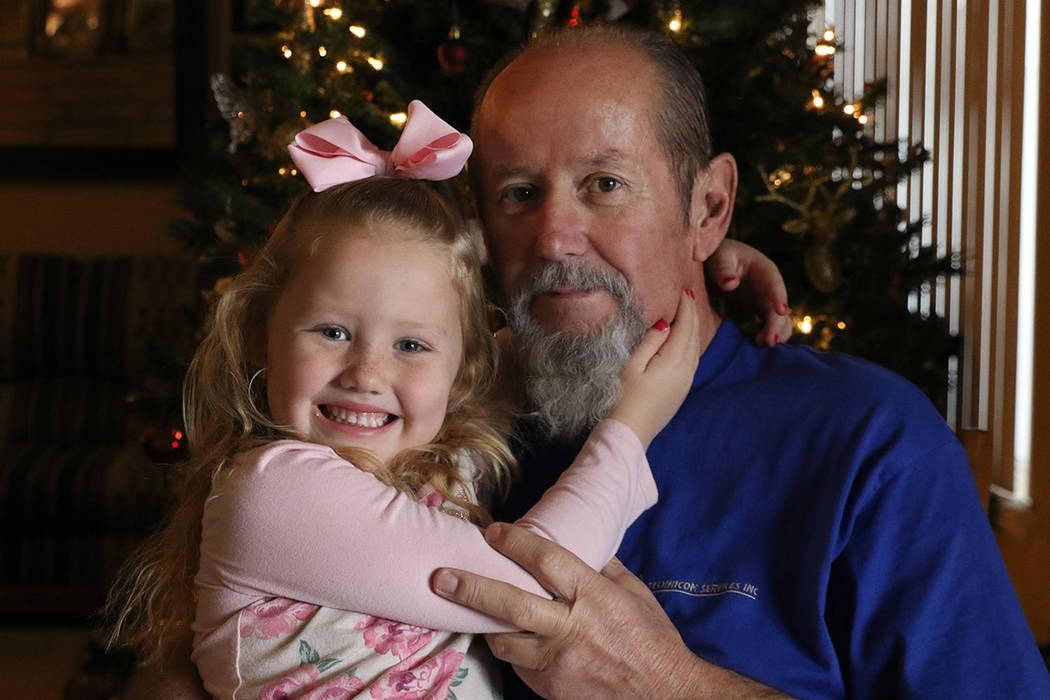 Arlie Daniel Jr., 59, poses for a photo with his granddaughter Aspyn, 4, at his Las Vegas home on Friday, Dec. 7, 2018. Bizuayehu Tesfaye Las Vegas Review-Journal @bizutesfaye