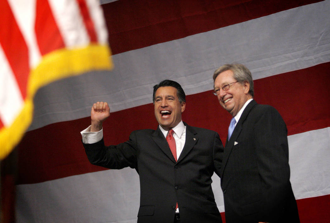 Gov.-elect Brian Sandoval, left, celebrates his victory with former Nevada governor Robert List at the Republican gathering at The Venetian in Las Vegas on Nov. 02, 2010. Jessica Ebelhar Las Vega ...