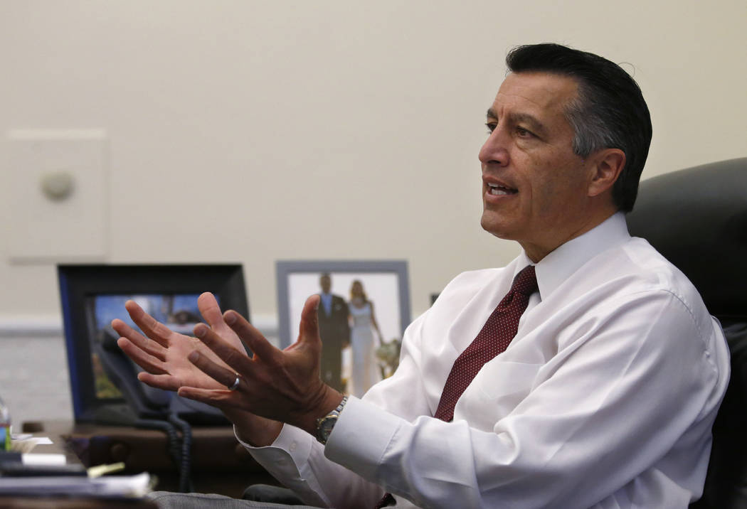 Nevada Gov. Brian Sandoval, who left a lifetime appointment to the federal bench, looks back on eight years as Governor from his office at the Capitol, in Carson City, on Monday, Dec. 17, 2018. (C ...