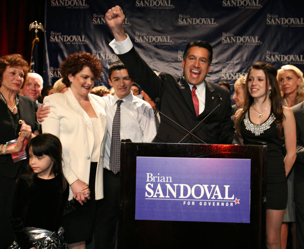 Nevada Gov.-elect Brian Sandoval, center, celebrates with supporters and members of his family including, from left, six-year-old daughter Marisa, wife Kathleen, 15-year-old son James and 13-year- ...