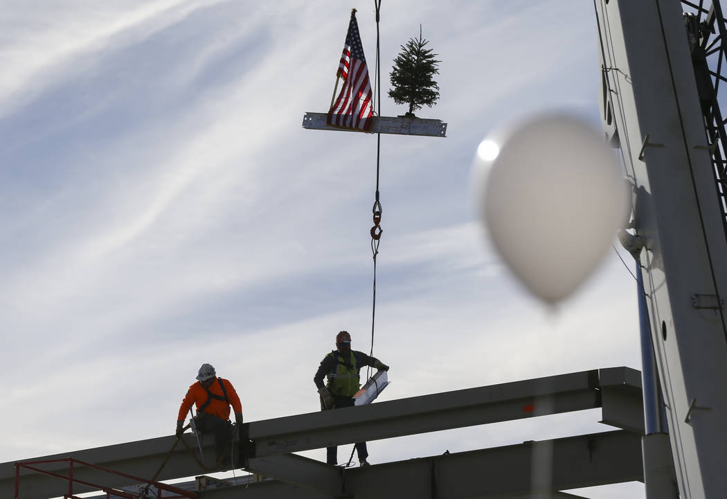 Three steel beams are lowered during a topping off ceremony of the student union building at the College of Southern Nevada North Las Vegas campus on Tuesday, Dec. 18, 2018. Chase Stevens Las Vega ...