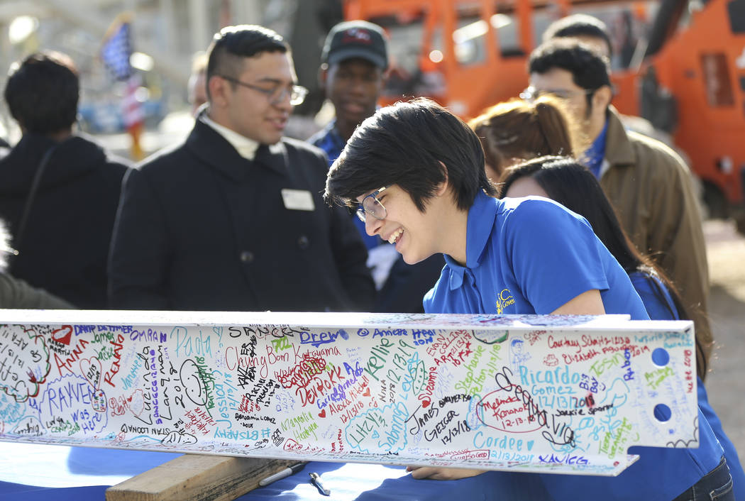 Isabela De Las Casas, student government secretary at College of Southern Nevada, signs a steel beam during a topping off ceremony of the student union building at the CSN North Las Vegas campus o ...