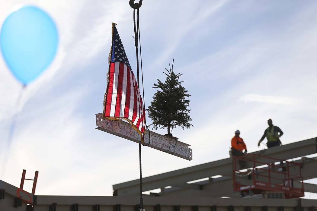 Three steel beams are raised for a topping off ceremony of the student union building at the College of Southern Nevada North Las Vegas campus on Tuesday, Dec. 18, 2018. Chase Stevens Las Vegas Re ...