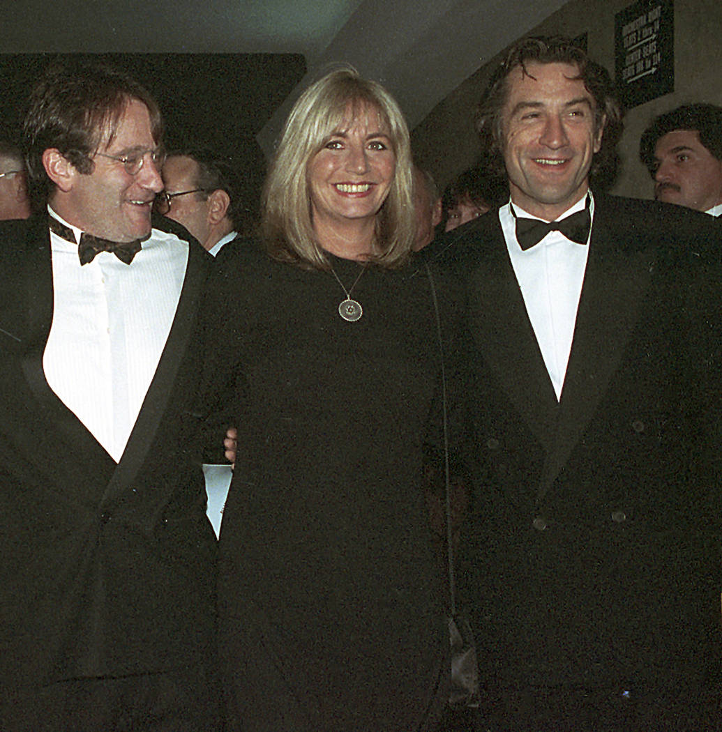 "Director Penny Marshall poses with co-stars of ""Awakenings"" Robin Williams, left, and Robert De Niro at the premiere of the film in New York, Dec. 17, 1990. Marshall died of complications from dia ..."