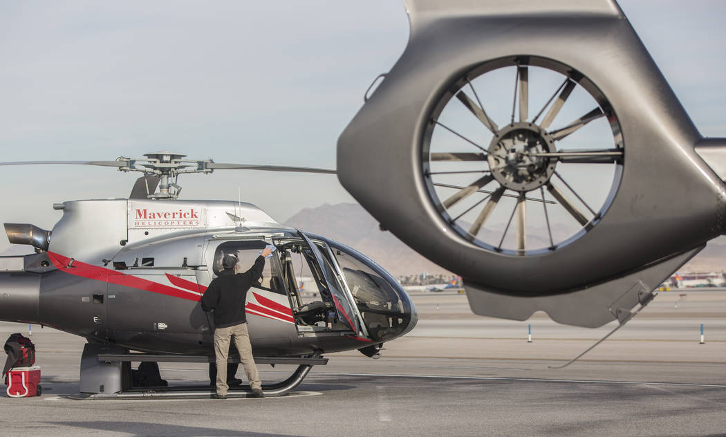 A Maverick tour helicopter is cleaned after dropping off a tour group on Tuesday, Dec. 18, 2018, at Maverick Helicopters, in Las Vegas. Benjamin Hager Las Vegas Review-Journal