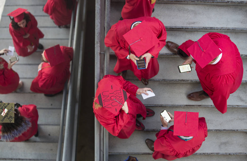 Students wait in the stairwell of Cox Pavilion before the start of UNLV's winter graduation ceremony on Tuesday, Dec. 18, 2018, in Las Vegas. Benjamin Hager Las Vegas Review-Journal