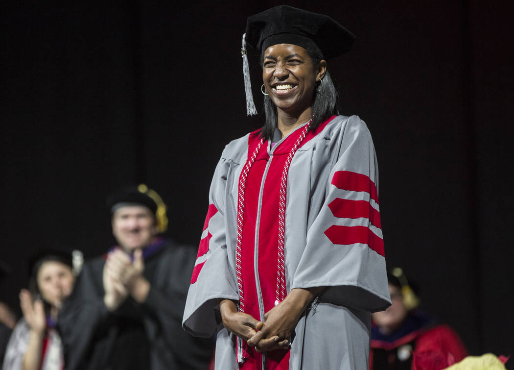 Schetema Nealy smiles into the crowd after earning her Ph.D. in Chemistry during UNLV's winter graduation ceremony on Tuesday, Dec. 18, 2018, at the Thomas & Mack Center, in Las Vegas. Benjamin Ha ...