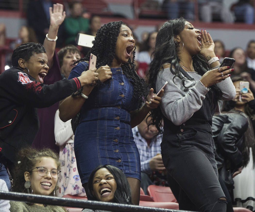 Family and friends celebrate as graduates are called onto the stage during UNLV's winter graduation ceremony on Tuesday, Dec. 18, 2018, at the Thomas & Mack Center, in Las Vegas. Benjamin Hage ...