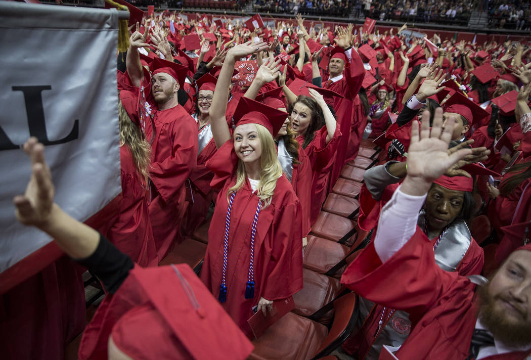 Amanda Noyce, middle, waves at her family after earning her degree in French during UNLV's winter graduation ceremony on Tuesday, Dec. 18, 2018, at the Thomas & Mack Center, in Las Vegas. Benj ...