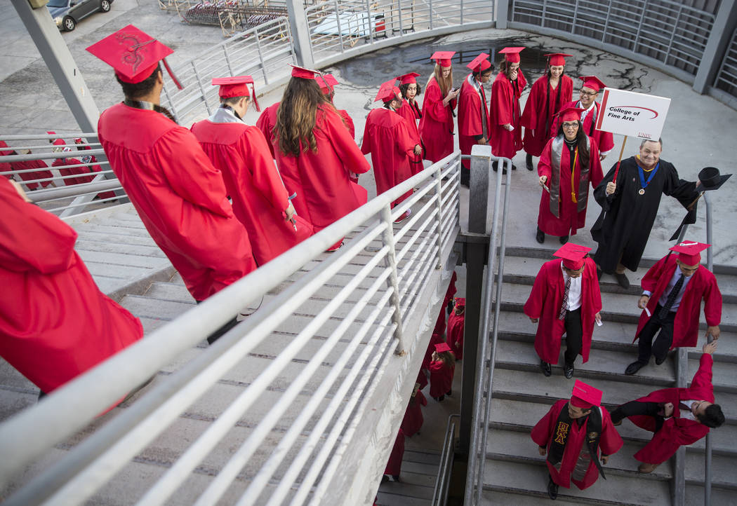 Students in the Fine Arts Department wait in the stairwell at Cox Pavilion before the start of UNLV's winter graduation on Tuesday, Dec. 18, 2018, in Las Vegas. Benjamin Hager Las Vegas Review-Journal