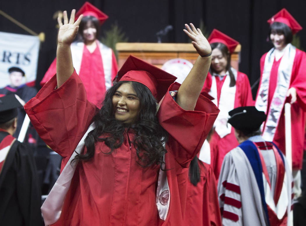 Jacqueline Marquez celebrates with classmates after earning her degree in Hospitality Management during UNLV's winter graduation ceremony on Tuesday, Dec. 18, 2018, at the Thomas & Mack Center ...