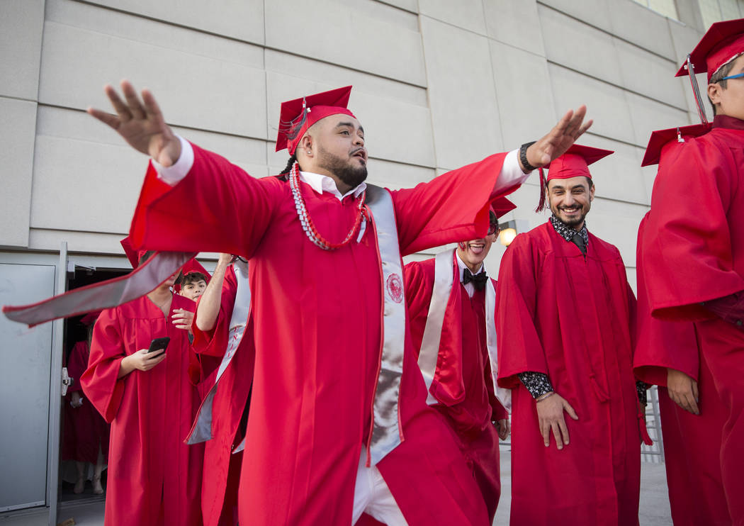 Students in the Fine Arts Department dance outside of Cox Pavilion before the start of UNLV's winter graduation ceremony on Tuesday, Dec. 18, 2018, in Las Vegas. Benjamin Hager Las Vegas Review-Jo ...
