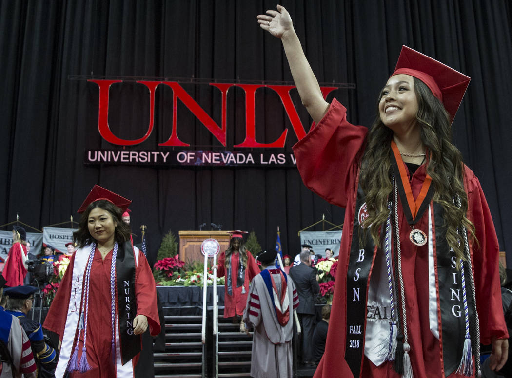 Rosalind Marie Buslon, right, waves to her family after earning her Nursing Degree during UNLV's winter graduation ceremony on Tuesday, Dec. 18, 2018, at the Thomas & Mack Center, in Las Vegas ...