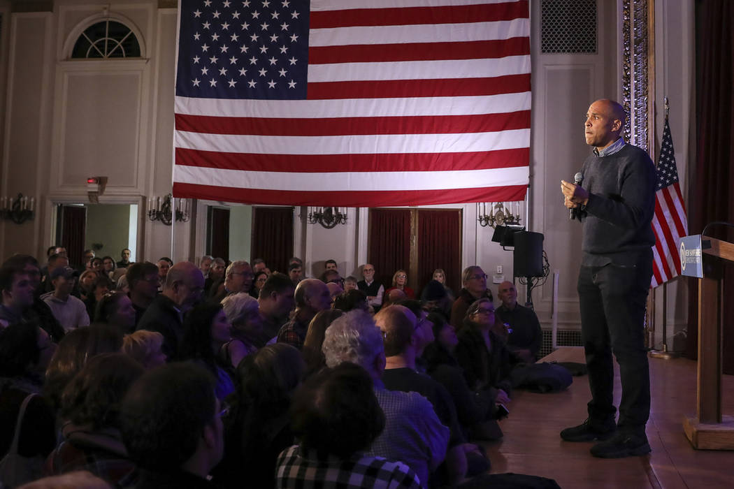 U.S. Sen. Cory Booker, D-N.J., pauses while sharing a personal story while speaking at a post-midterm election victory celebration in Manchester, N.H., on Saturday, Dec. 8, 2018. (AP Photo/Cheryl ...