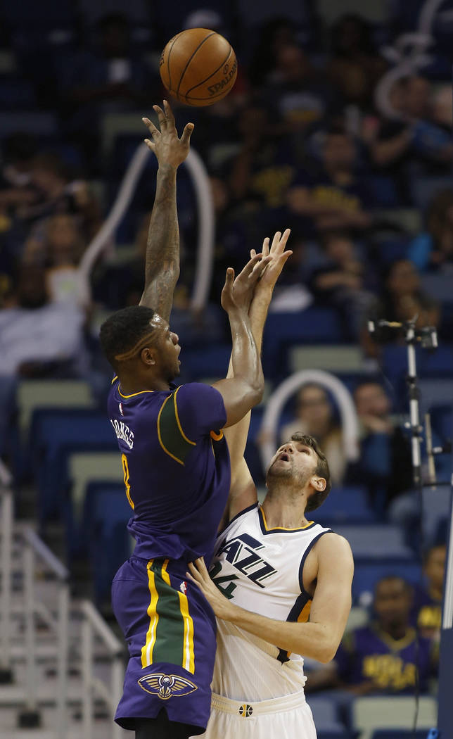 New Orleans Pelicans forward Terrence Jones (9) shoots over Utah Jazz center Jeff Withey in the second half of an NBA basketball game in New Orleans, Wednesday, Feb. 8, 2017. Jazz won 127-94. (AP ...