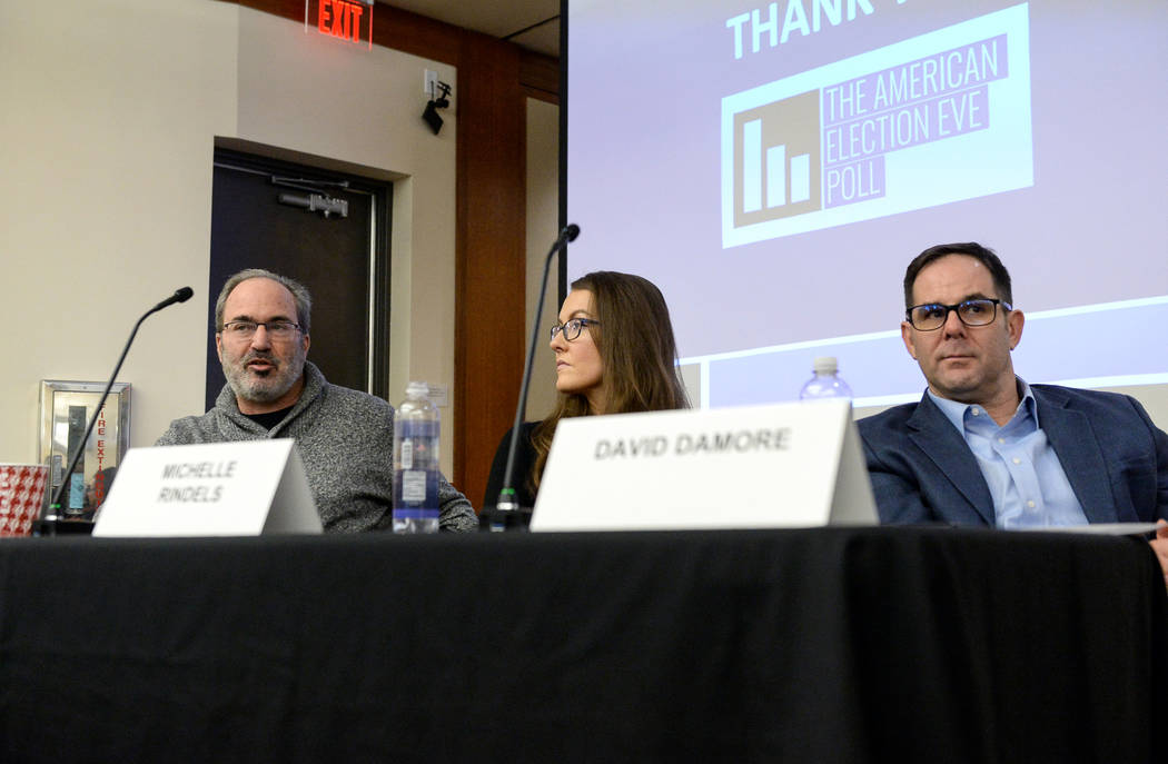 Jon Ralston, left, speaks during a panel to discuss the impact of the results of the recent midterm elections as Michelle Rindels, center, and David Damore listen at the William S. Boyd School of ...