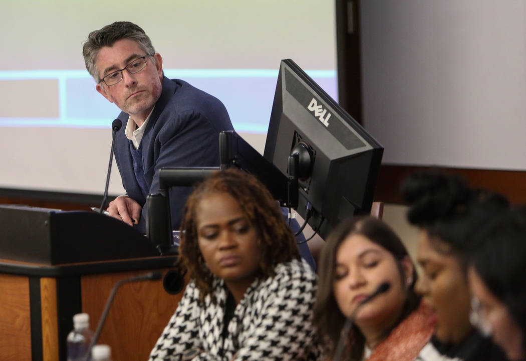 Michael Kagan leans in to listen as Amanda Khan discusses the impact of the results of the recent midterm elections at the William S. Boyd School of Law at UNLV in Las Vegas, Tuesday, Dec. 18, 201 ...