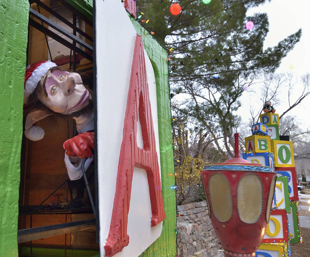 Elves peeking out of giant building blocks are part of the Christmas display. (Bill Hughes/Real Estate Millions)