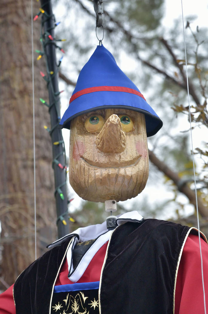 A giant wooden Pinocchio is part of the Christmas display. (Bill Hughes/Real Estate Millions)