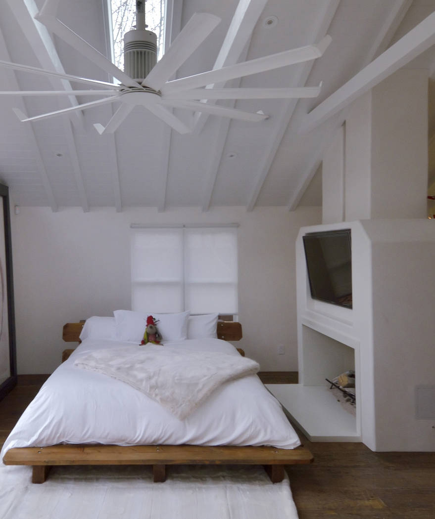 A queen-size, platform bed is made from inexpensive leftover floor planks. (Bill Hughes/Real Estate Millions)