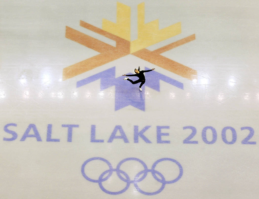 U.S. champion Michelle Kwan practices for the women's short program in this Feb. 8, 2002, photo before the Winter Olympic Games at the Salt lake Ice Center in Salt Lake City. (AP Photo/Doug Mills, ...