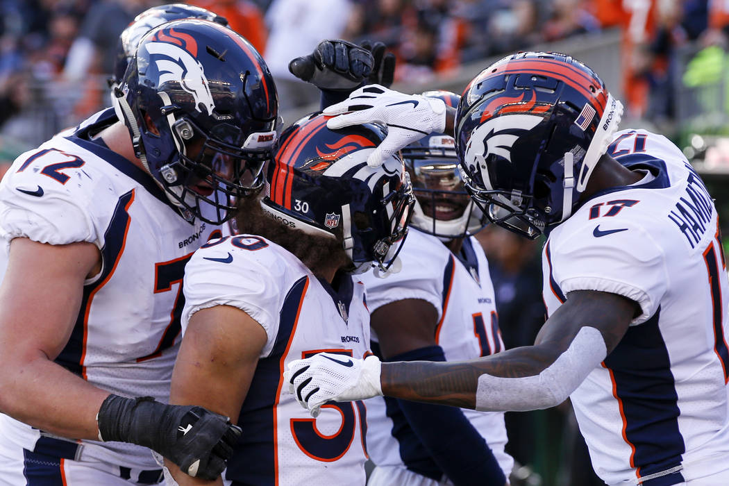 05bbe6f9c Denver Broncos running back Phillip Lindsay (30) celebrates his touchdown  with his teammates in