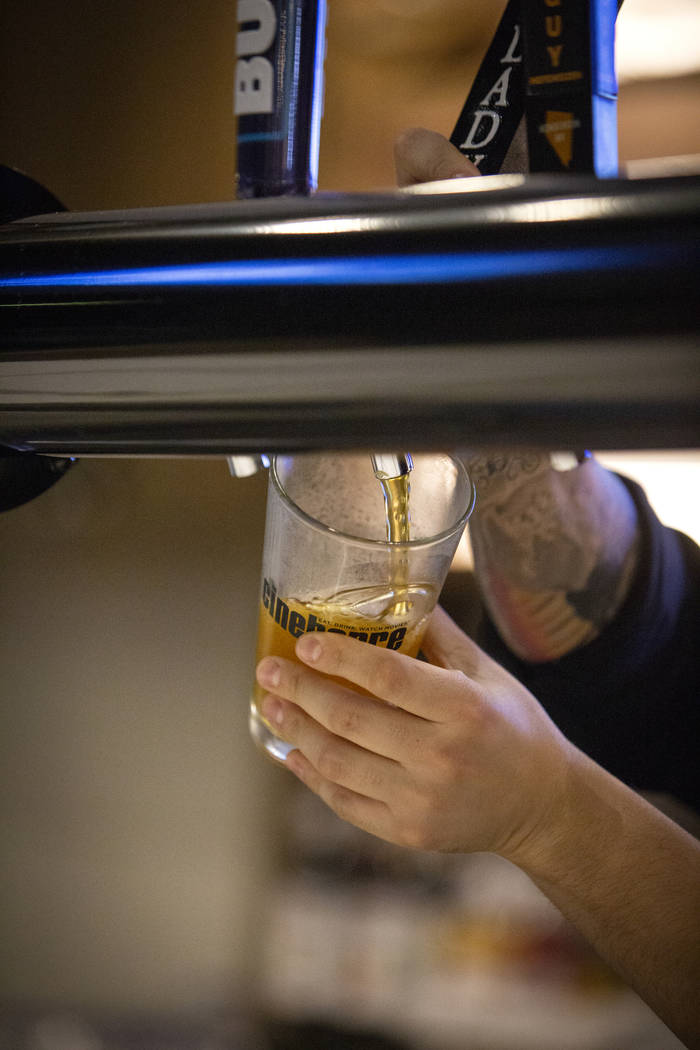 An employee pours a beer at Regal's Cinebarre, Palace Station's new movie theater as it hosts its grand opening in Las Vegas, Tuesday, Dec. 18, 2018. Caroline Brehman/Las Vegas Review-Journal