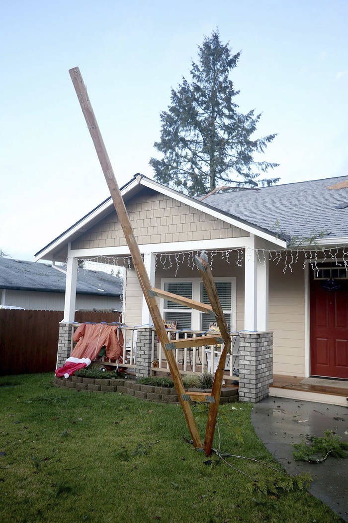 A roof strut sticks up out of a yard on Plymouth Way after a tornado touched down in Port Orchard, Wash., on Tuesday, Dec. 18, 2018. A rare tornado touched down in a Seattle suburb on Tuesday, dam ...