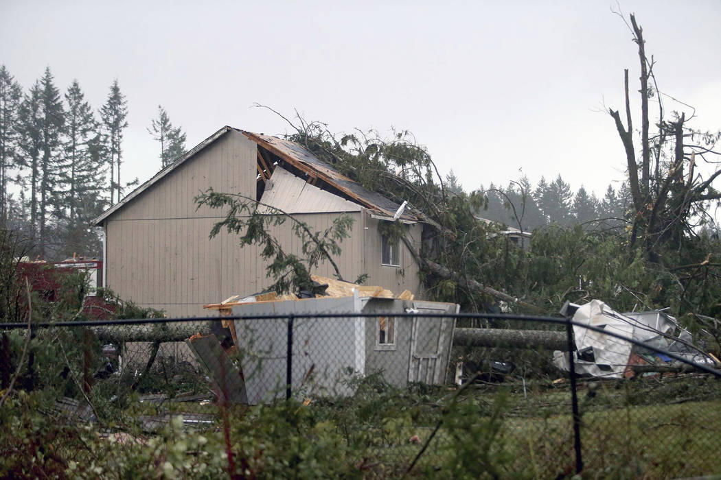 A home that was damaged near the Walmart in Port Orchard, Wash., on Tuesday, Dec. 18, 2018, after a tornado touched down. A rare tornado touched down in a Seattle suburb on Tuesday, damaging sever ...