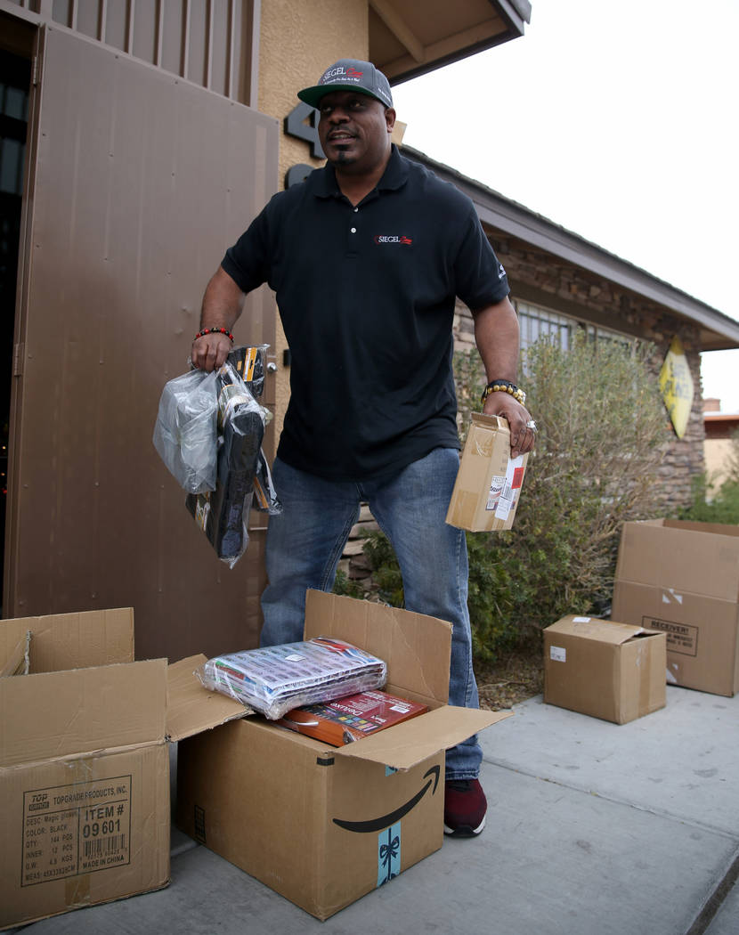 Mark Lenoir, community relations for The Siegel Group, drops off a donation at Nevada Partnership for Homeless Youth in Las Vegas Friday, Dec. 14, 2018. The donation is part of the Siegel Cares pr ...