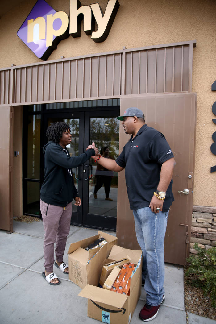 Mark Lenoir, community relations for The Siegel Group, drops off a donation Tayvon, 22, at Nevada Partnership for Homeless Youth in Las Vegas Friday, Dec. 14, 2018. The donation is part of the Sie ...