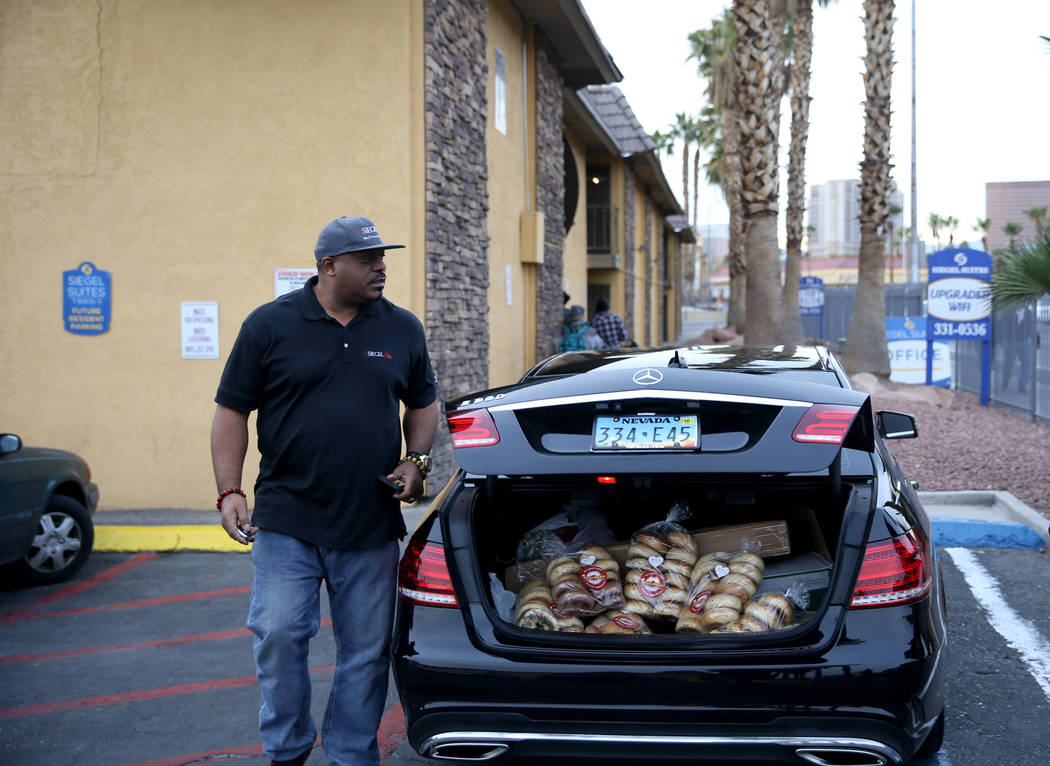 Mark Lenoir, community relations for The Siegel Group prepares to drop off a donation of Bagelmania bagels to Siegel Suites Twain II in Las Vegas Friday, Dec. 14, 2018. The donation is part of the ...