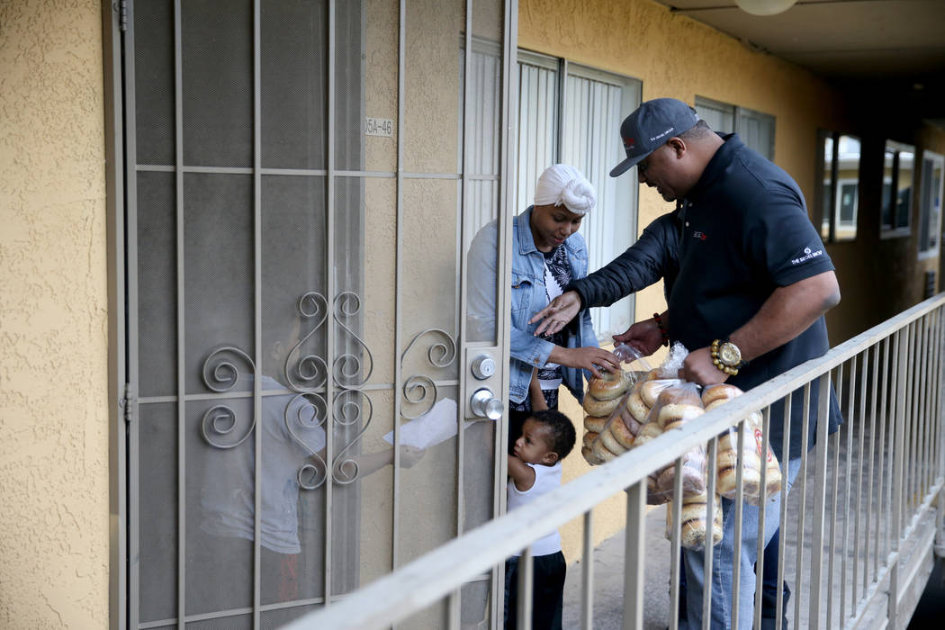 Mark Lenoir, community relations for The Siegel Group, drops off a donation of Bagelmania bagels to residents at Siegel Suites Twain II in Las Vegas Friday, Dec. 14, 2018. The donation is part of ...