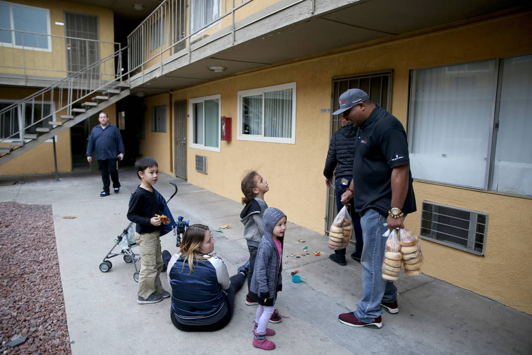 Mark Lenoir, community relations for The Siegel Group, drops off a donation of Bagelmania bagels to Siegel Suites Twain II in Las Vegas with Assistant General Manager Eugenia Hunter Friday, Dec. 1 ...