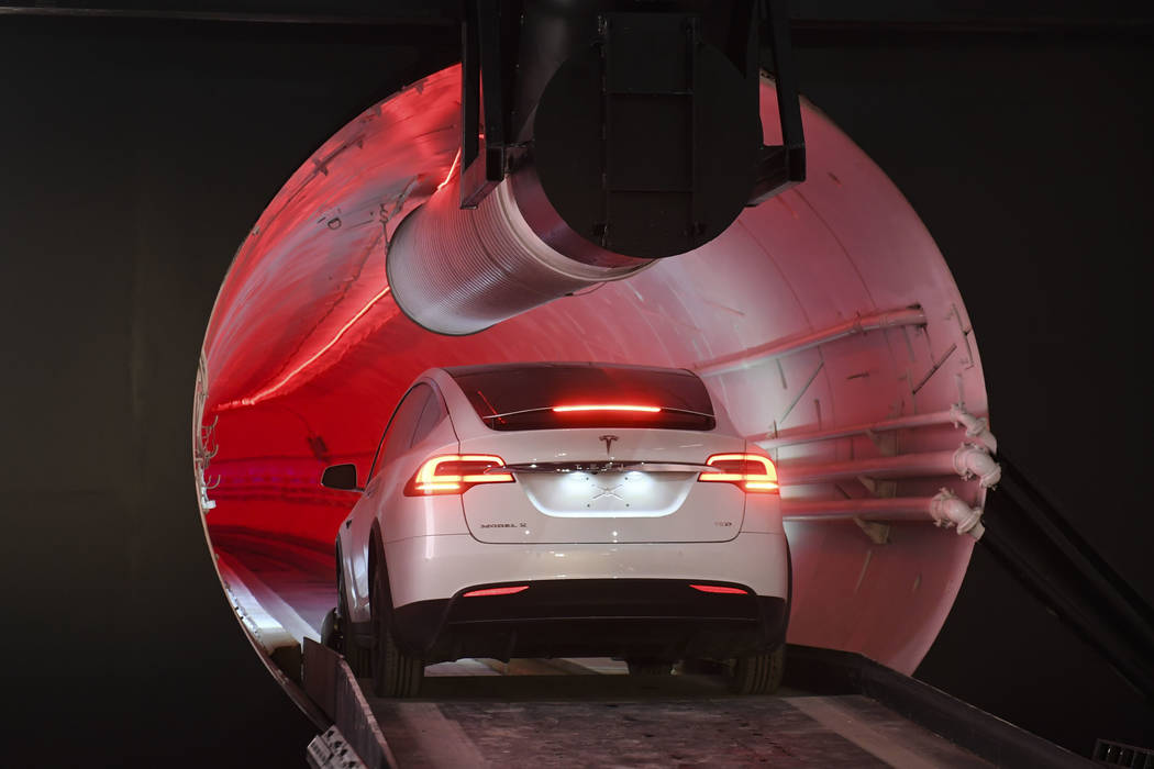 A modified Tesla Model X drives in the tunnel entrance before an unveiling event for the Boring Co. Hawthorne test tunnel in Hawthorne, Calif., Tuesday, Dec. 18, 2018. Elon Musk unveiled his under ...