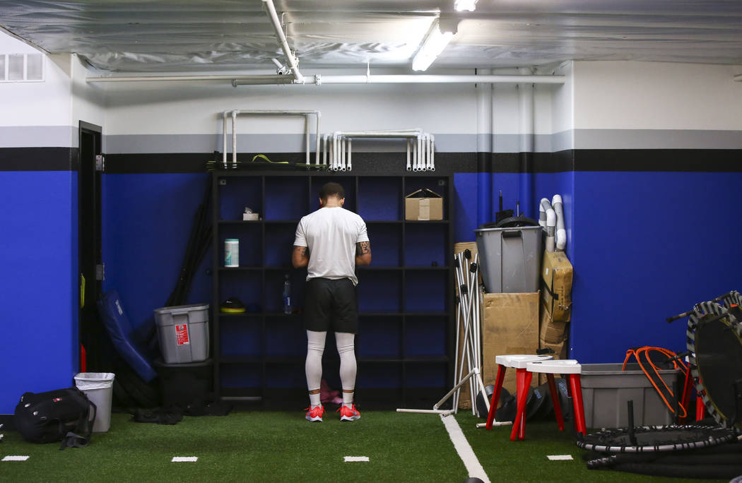 Former Desert Pines wide receiver Jaden Mitchell gets ready to work out at Game Changers Sports in Las Vegas the morning after signing his letter of intent with Arizona on Wednesday, Dec. 19, 2018 ...