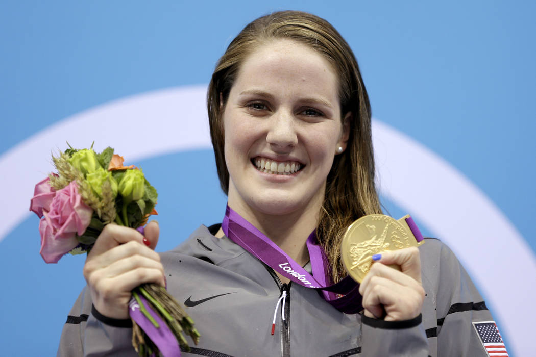 In this Aug. 3, 2012, file photo, United States' Missy Franklin holds her gold medal in the women's 200-meter backstroke final at the Aquatics Centre in the Olympic Park during the 2012 Summer Oly ...