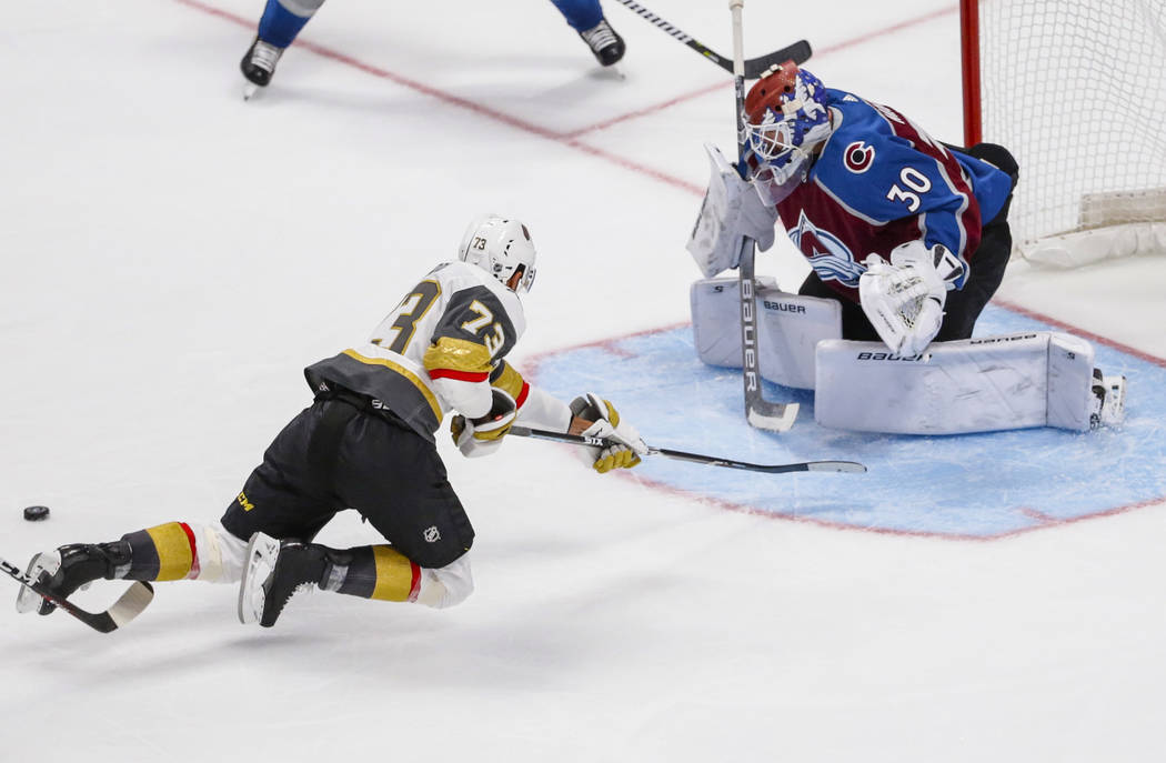 Vegas Golden Knights center Brandon Pirri (73) misses the puck on a shot against Colorado Avalanche goaltender Spencer Martin (30) during the third period of a preseason NHL hockey game, Tuesday, ...