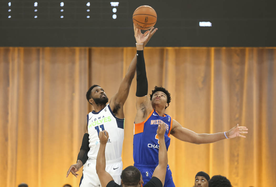 Iowa Wolves center Hakim Warrick (11) and Westchester Knicks center Isaiah Hicks (4) tip off to start the first half of an NBA G League Winter Showcase basketball game at the Mandalay Bay Conventi ...