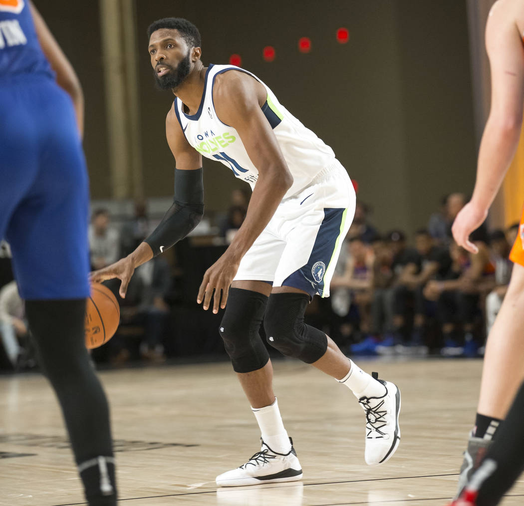 Iowa Wolves center Hakim Warrick (11) dribbles the ball against Westchester Knicks defenders during the first half of an NBA G League Winter Showcase basketball game at the Mandalay Bay Convention ...
