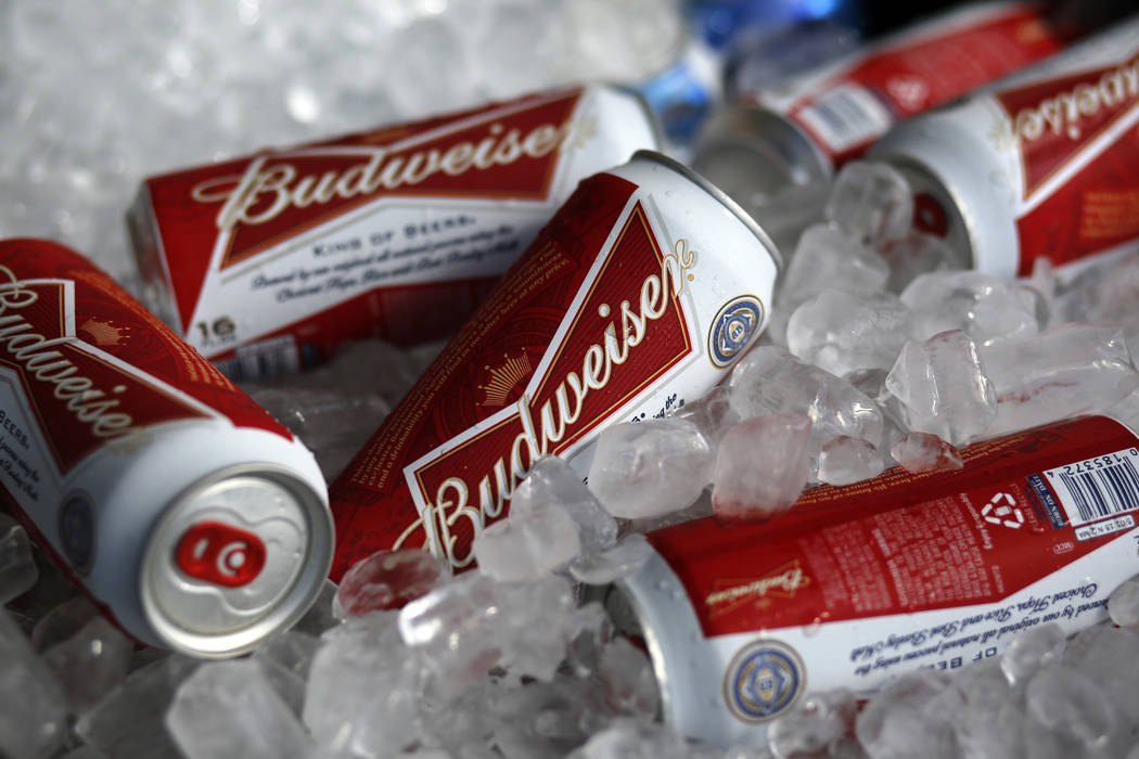 In this March 5, 2015, file photo, Budweiser beer cans are on ice at a concession stand at McKechnie Field in Bradenton, Fla. The maker of Budweiser is partnering with medical cannabis company Til ...