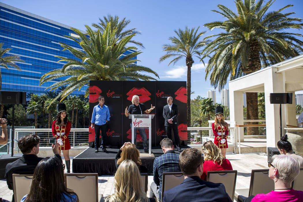 Virgin Group Founder Sir Richard Branson, center, Partner and Property CEO Richard ÒBozÓ Bosworth, center right, and Virgin Hotels CEO Raul Leal take questions during a press conference ...