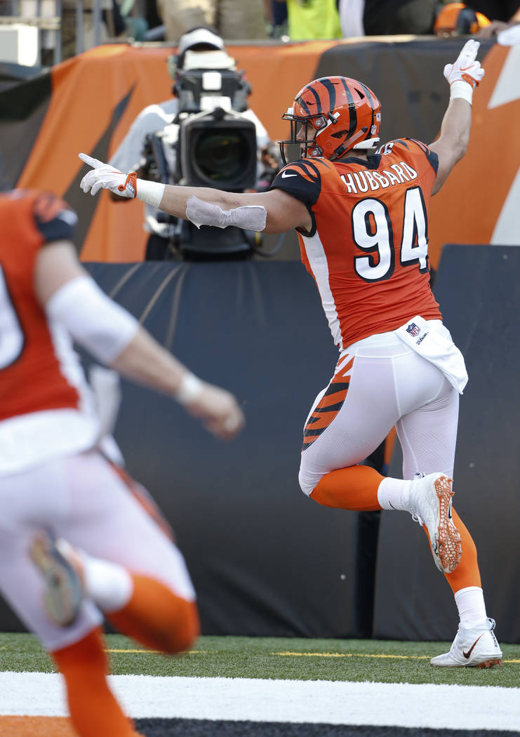 Cincinnati Bengals defensive end Sam Hubbard (94) celebrates a touchdown on a fumble return against the Miami Dolphins during the second half of an NFL football game in Cincinnati, Sunday, Oct. 7, ...