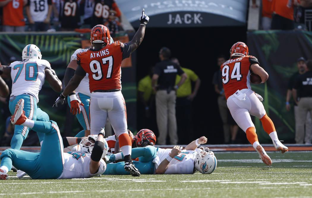 Cincinnati Bengals defensive end Sam Hubbard (94) returns a fumble by Miami Dolphins quarterback Ryan Tannehill (17) for touchdown during the second half of an NFL football game in Cincinnati, Sun ...