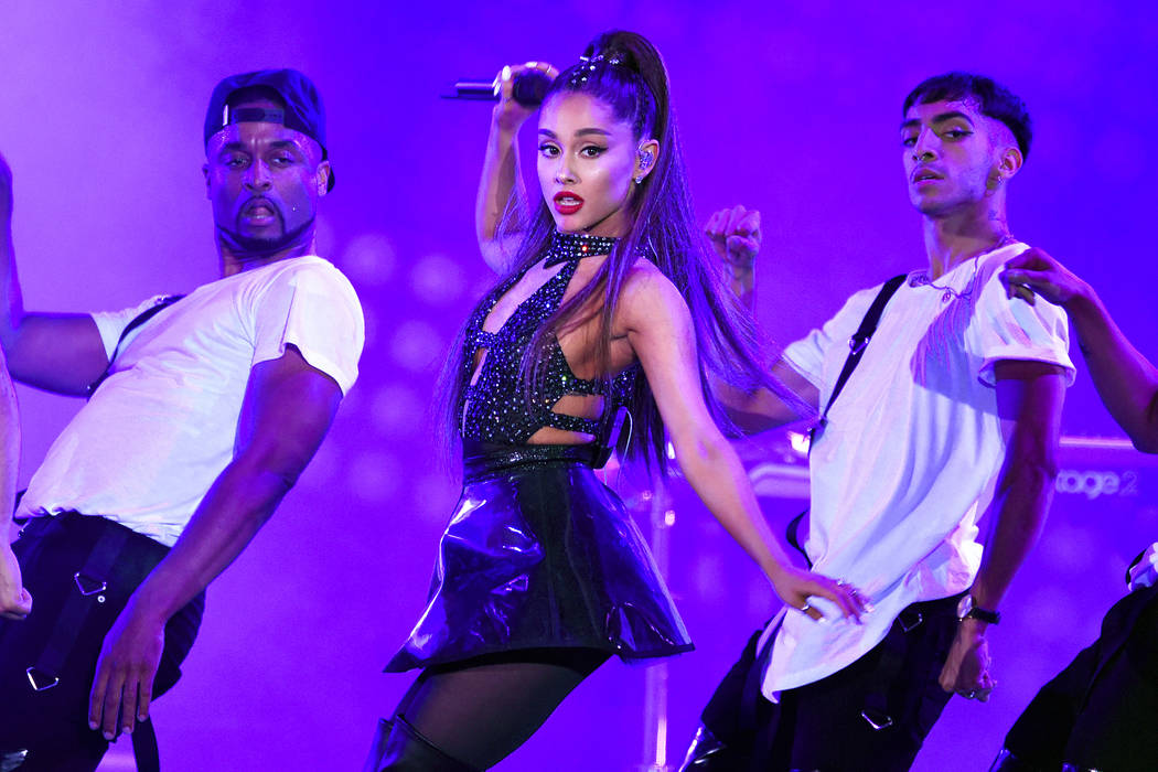 Ariana Grande, center, performs at Wango Tango in Los Angeles on June 2, 2018. (Chris Pizzello/Invision/AP, File)