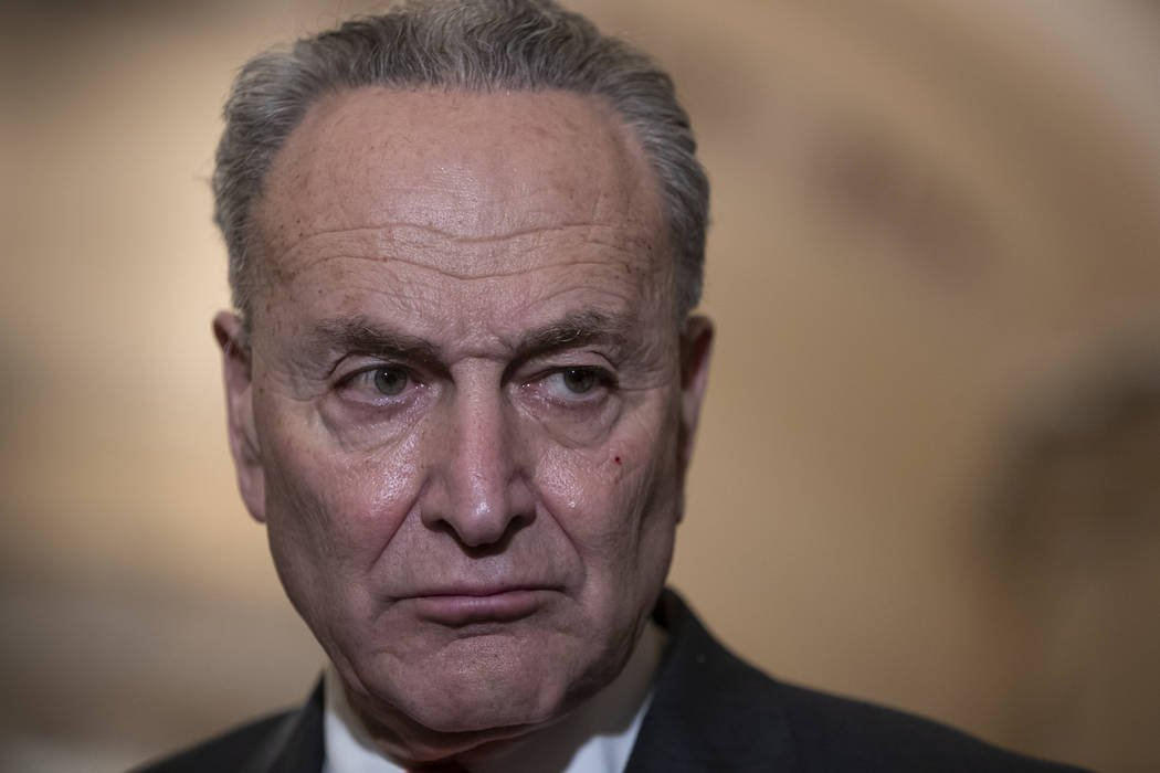 Senate Minority Leader Chuck Schumer, D-N.Y., speaks to reporters about the possibility of a partial government shutdown, at the Capitol in Washington, Tuesday, Dec. 18, 2018. Congress and Preside ...