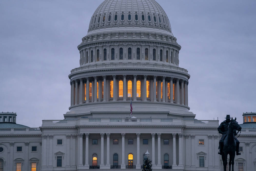 The Capitol is seen under early morning gray skies in Washington, Thursday, Dec. 20, 2018. (AP Photo/J. Scott Applewhite)