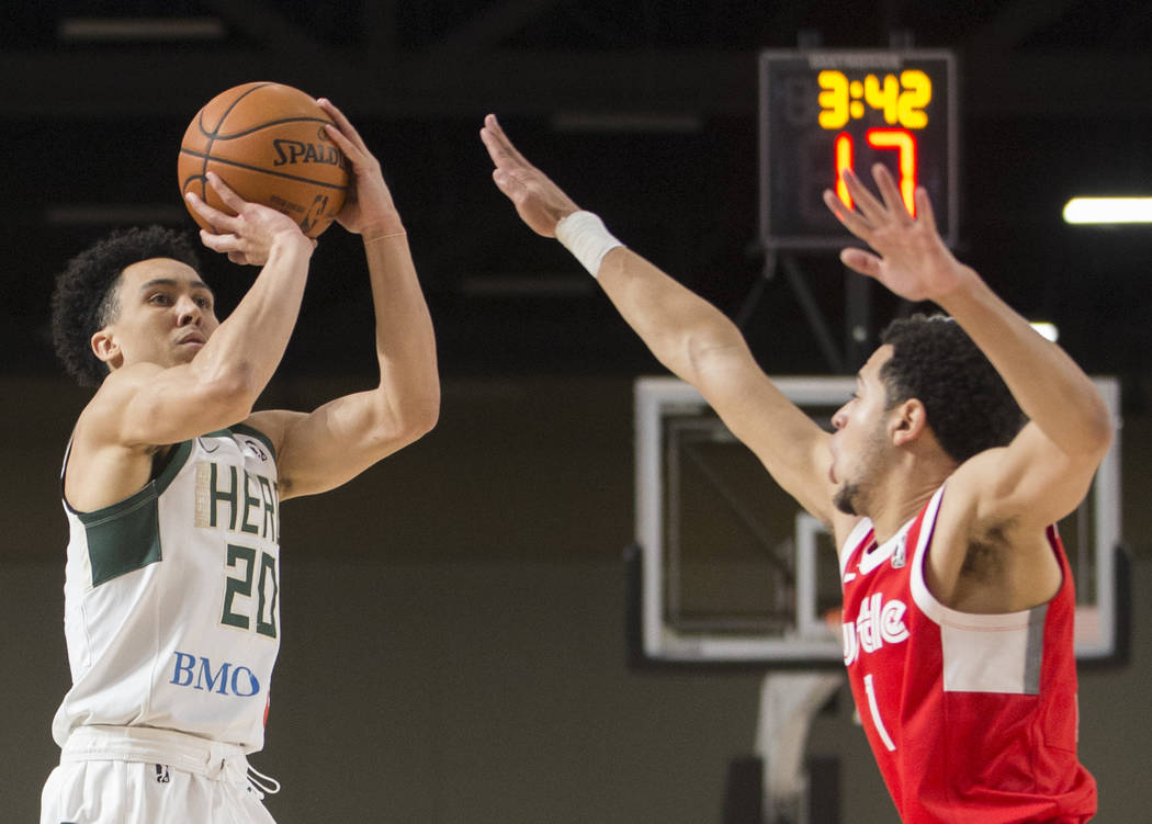 Wisconsin Herd guard Travis Trice (20) shoots a three point shot over Memphis Hustle guard Tyler Harvey (1) in the third quarter during their G League game at the Mandalay Bay Convention Center on ...